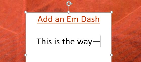 Add an Em Dash in PowerPoint for Windows